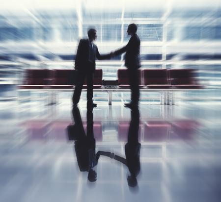 technology agreement: Businessmen Talking Business Airport Deal Concept
