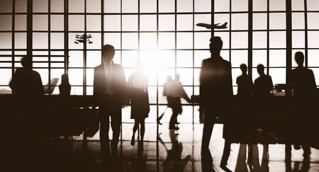 flight mode: Crowd People Silhouette Busy Airport Terminal Concept Stock Photo