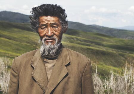 mongolian: Portrait Mongolian Man Field Senior Tranquil Solitude Concept Stock Photo