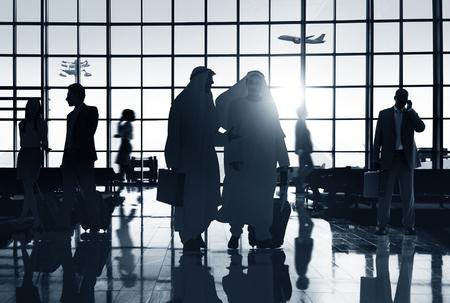 バックライト空港旅客概念を旅するビジネス人々 写真素材