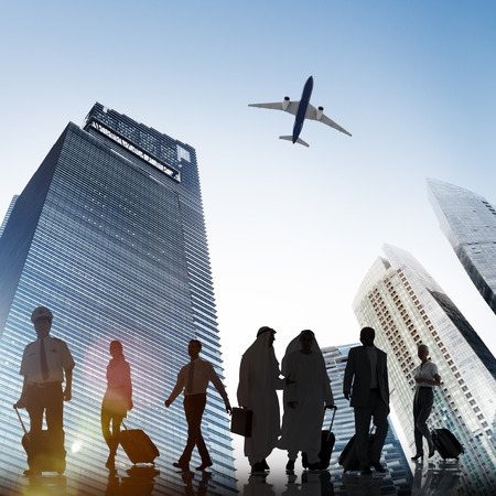 business scene: Business People Walking Corporate Travel Airplane Concept