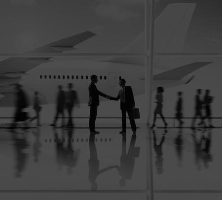 flight mode: Businessmen Airport Handshake Deal Business Concept