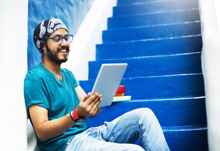 stair well: Sikh Guy Browsing Tablet Stair Case Concept Stock Photo