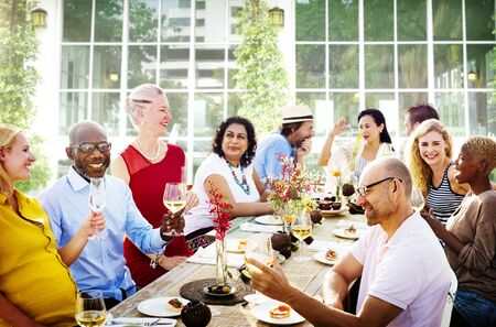 senior adults: Friends Dining Outdoors Party Cheerful Concept Stock Photo