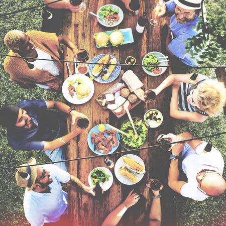 family dinner: Friends Friendship Outdoor Dining People Concept Stock Photo