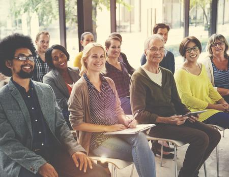 Multi-Ethnic Group of People in Seminar Concept Standard-Bild