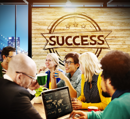 People in a meeting with the word SUCCESS Stock Photo