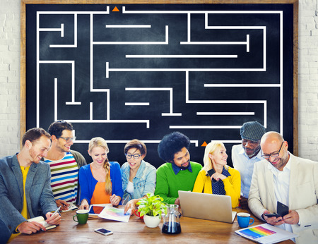 Group of people with maze background Stock Photo