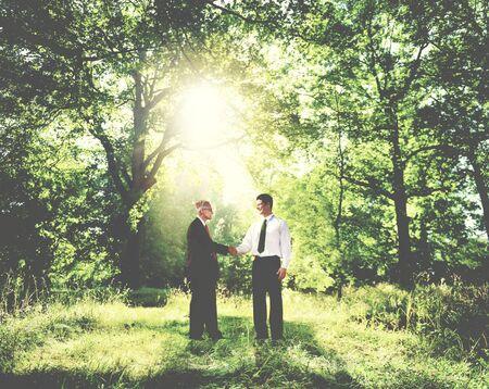 shaking: Businessmen Shaking Hands Outdoors Partnership Concept