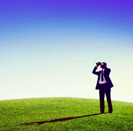 observing: Business man observing nature telescope outdoors Concept Stock Photo