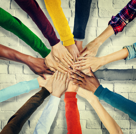 race relations: Group of Human Hands Holding Together Concept