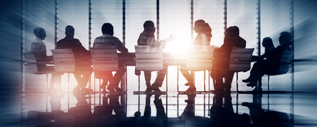 Group of Business People Meeting Back Lit Concept Banco de Imagens