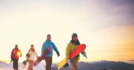 sport and leisure: People Snow Boarding Winter Mountain Leisure Sport Concept Stock Photo