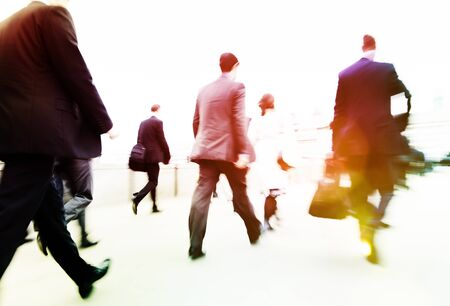 rushing hour: Commuter Business People Commuter Crowd Walking Concept Stock Photo