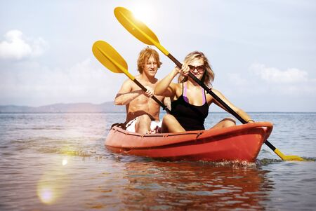 adventure travel: Kayaking Adventure Happiness Recreational Pursuit Couple Concept Stock Photo