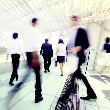 blurred motion: Business people in Asia. Hong Kong. Tilt shift lense with selective focus, Blurred motion. Blue tint. Stock Photo