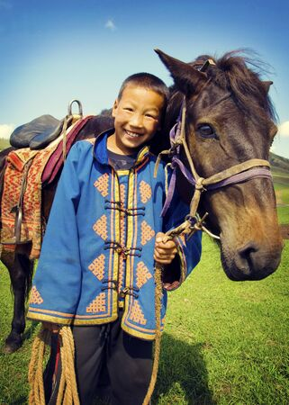independent mongolia: Little Boy Tilting His Head To His Horse And Smiling Concept