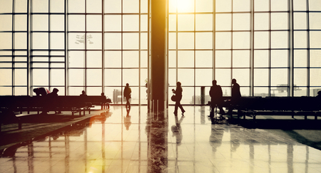 people travelling: International Airport Traveling Airplane Airport Concept Stock Photo