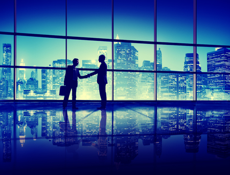 asia business: Business People Handshake Silhouette Concept Stock Photo