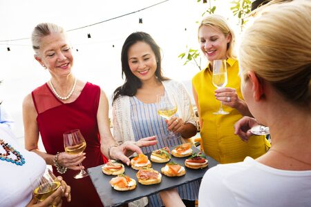 hanging out: Diverse People Luncheon Outdoors Hanging out Concept