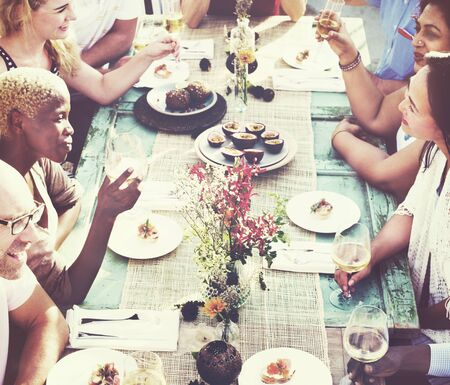 eating: Friends Dining Holiday Hanging out Togetherness Concept Stock Photo