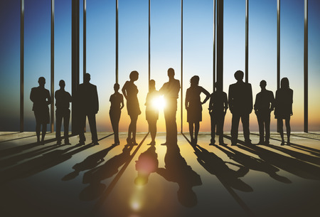 team success: Confident Silhouette Of Business People Team Concept Stock Photo
