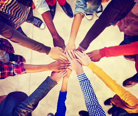 join hands: Group of Diverse Multiethnic People Teamwork Concept