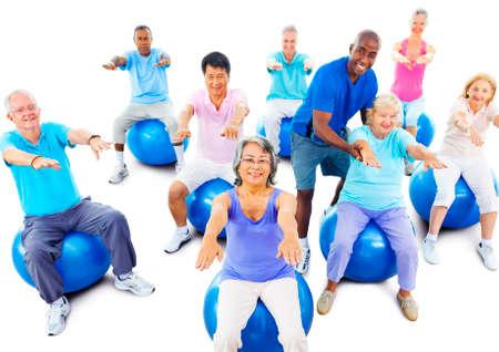 pilates man: Group Of Multi-Ethnic Senior Adults Exercising Yoga Concept