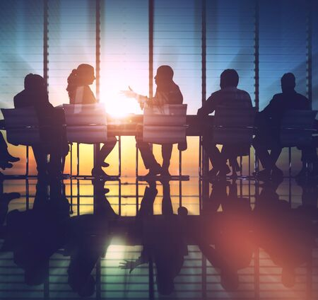 Group of Business People Meeting Back Lit Concept Stock Photo