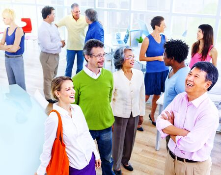organised group: Group of Business People in the Office Concept Stock Photo