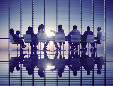 discussion: Business People Meeting Discussion Back Lit Concept Stock Photo