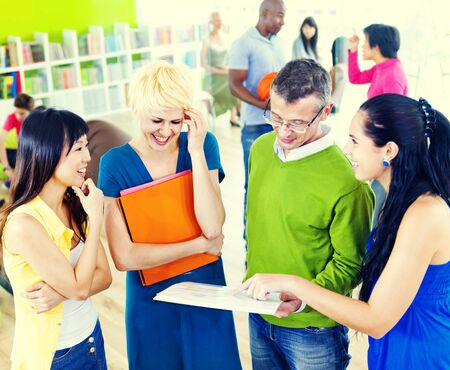 teaching adult: College Students Learning Education University Teaching Concept Stock Photo