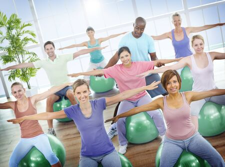 pilates man: Group of Healthy People in the Fitness Exercising Concept
