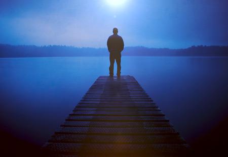 deliberation: Man Standing Jetty Tranquil Lake Gloomy Fog Dusk Concept