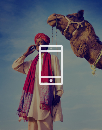 asian and indian ethnicities: Mobile Phone Mobility Wireless Technology Concept Stock Photo