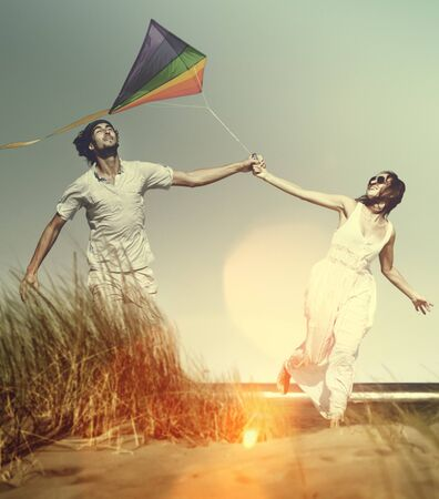 kites: Couple Beach Holiday Flying Kite Sea Togetherness Concept