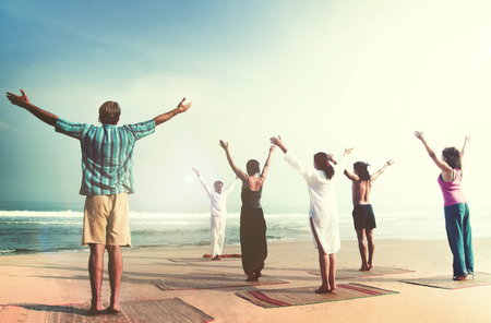 diversity people: Yoga Wellbeing Exercise Beach Concept