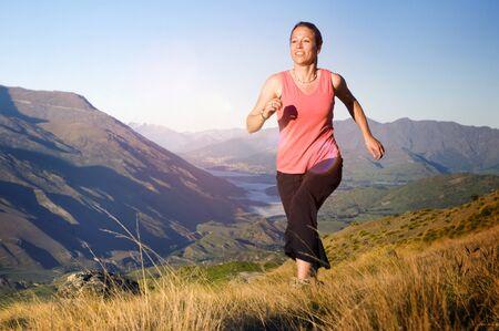 run out: Woman Jogging Exercise Mountain Range Concept