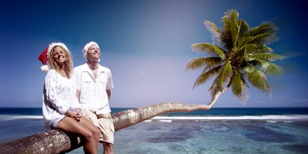 Couple Relaxing on the Beach Honeymoon Concept