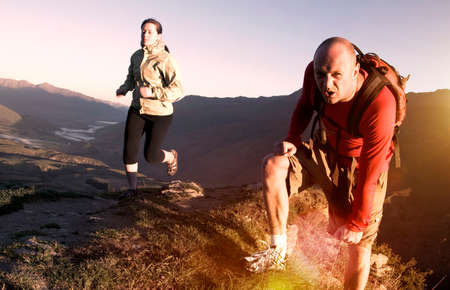 healthy sport: Extreme Athletes Exercising in the Mountains Concept Stock Photo