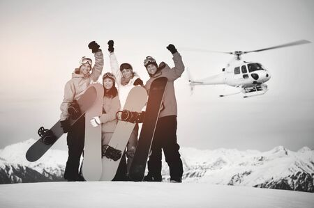 helicopter: Snowboarders Mountain Ski Extreme Helicopter Concept Stock Photo