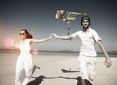 kite: Couple Beach Holiday Flying Kite Sea Togetherness Concept