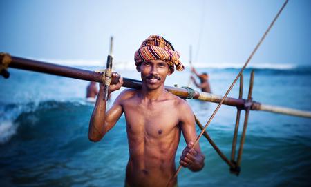 manual job: Smiling Fisherman Portrait Cultural Fishing Concept
