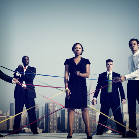 string together: Business People Connected By Strings Concept Stock Photo