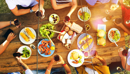people eating restaurant: Friends Friendship Outdoor Dining People Concept Stock Photo