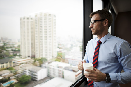 positive: Businessman Holding coffee Thinking Relax Concept