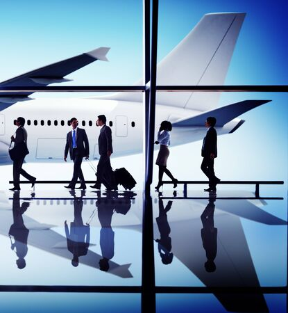 business travel: Business People Traveling Airplane Airport Concept Stock Photo