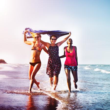women friendship: Femininity Girls Summer Beach Vacations Concept Stock Photo