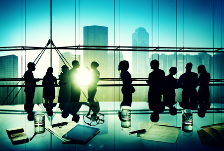 negotiation business: Silhouettes of Business People Brainstorming Meeting Concept Stock Photo