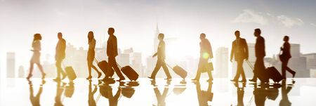 organised group: Group of Business People in Town Travel Walking Concpet Stock Photo